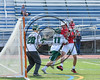 Baldwinsville Bees Peter Fiorni III (13) gets checked by Fayetteville-Manlius Hornets Luke Hamel (11) in front of Hornets goalie Ryan Boshart (28) in Section III Class A Semifinals Boys Lacrosse action at Michael Bragman Stadium in Cicero, New York on Tuesday, May 23, 2017.  Baldwinsville won 9-8 in OT.