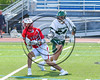 Baldwinsville Bees Austin Bolton (15) avoiding Fayetteville-Manlius Hornets defender Ben Welling (24) in Section III Class A Semifinals Boys Lacrosse action at Michael Bragman Stadium in Cicero, New York on Tuesday, May 23, 2017.  Baldwinsville won 9-8 in OT.