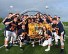 East Syracuse-Minoa Spartans players celebrating their Section III Class B Finals Boys Lacrosse championship over the Auburn Maroons at Michael Bragman Stadium in Cicero, New York on Thursday, May 25, 2017.  East Syracuse-Minoa won 8-7.