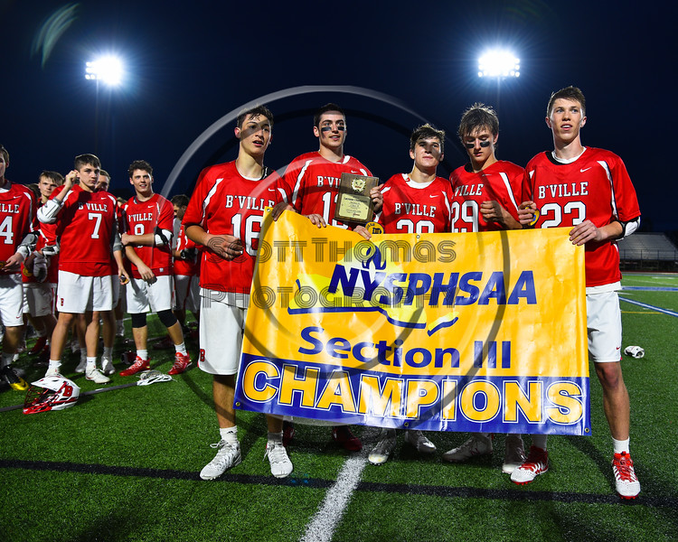Baldwinsville Bees Captains Frank Delia (16), Peter Fiorni III (13), Ryan Gebhardt (20),Kyle Pelcher (29) and Matt Dickman (23) displaying the Section III Championship banner for Class A Boys Lacrosse after defeating the West Genesee Wildcats at Michael Bragman Stadium in Cicero, New York on Thursday, May 25, 2017 by a score of 9-8.