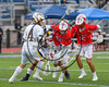 Baldwinsville Bees Ryan Gebhardt (20) and Austin Bolton (15) go after a ground ball against West Genesee Wildcats Kevin Snow (14) in Section III Class A Finals Boys Lacrosse action at Michael Bragman Stadium in Cicero, New York on Thursday, May 25, 2017.  Baldwinsville won 9-8.