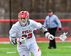 Baldwinsville Bees Brendan Wilcox (22) with the ball against the Pittsford Panthers in Section III Boys Lacrosse action at the Pelcher-Arcaro Stadium in Baldwinsville, New York on Saturday, April 7, 2018.  Baldwinsville won 14-6.