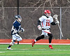 Baldwinsville Bees Connor Steria (16) bringing the ball up field against the Pittsford Panthers in Section III Boys Lacrosse action at the Pelcher-Arcaro Stadium in Baldwinsville, New York on Saturday, April 7, 2018.  Baldwinsville won 14-6.