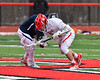 Baldwinsville Bees Tanner McCaffery (2) facing off against the Pittsford Panthers in Section III Boys Lacrosse action at the Pelcher-Arcaro Stadium in Baldwinsville, New York on Saturday, April 7, 2018.  Baldwinsville won 14-6.