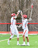 Baldwinsville Bees Cole Peters (11) celebrates his goal with Peter Fiorni III (13) against the Pittsford Panthers in Section III Boys Lacrosse action at the Pelcher-Arcaro Stadium in Baldwinsville, New York on Saturday, April 7, 2018.  Baldwinsville won 14-6.