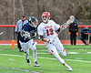 Baldwinsville Bees Peter Fiorni III (13) with the ball against the Pittsford Panthers in Section III Boys Lacrosse action at the Pelcher-Arcaro Stadium in Baldwinsville, New York on Saturday, April 7, 2018.  Baldwinsville won 14-6.