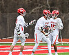 Baldwinsville Bees Brendan Wilcox (22) and Austin Bolton (15) congratulate Peter Fiorni III (13) on his goal against the Pittsford Panthers in Section III Boys Lacrosse action at the Pelcher-Arcaro Stadium in Baldwinsville, New York on Saturday, April 7, 2018.  Baldwinsville won 14-6.