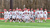 Baldwinsville Bees break their pre-game huddle to play the Pittsford Panthers in a Section III Boys Lacrosse game at the Pelcher-Arcaro Stadium in Baldwinsville, New York on Saturday, April 7, 2018.