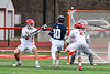 Baldwinsville Bees Ben Dwyer (5) and Tanner McCaffery (2) combine to knock the ball away from the Pittsford Panthers player in Section III Boys Lacrosse action at the Pelcher-Arcaro Stadium in Baldwinsville, New York on Saturday, April 7, 2018.  Baldwinsville won 14-6.