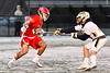 Baldwinsville Bees Cole Peters (11) being checked by West Genesee Wildcats Noah Sabatino (20) in Section III Boys Lacrosse action at Mike Messere Field in Camillus, New York on Tuesday, April 17, 2018.  Baldwinsville won 8-7.