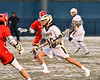 West Genesee Wildcats Tom Baker (28) running with the ball against the Baldwinsville Bees in Section III Boys Lacrosse action at Mike Messere Field in Camillus, New York on Tuesday, April 17, 2018.  Baldwinsville won 8-7.