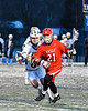 Baldwinsville Bees Brandon Mimas (21) running with the ball against the West Genesee Wildcats in Section III Boys Lacrosse action at Mike Messere Field in Camillus, New York on Tuesday, April 17, 2018.  Baldwinsville won 8-7.