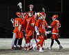 Baldwinsville Bees players celebrating their win over the West Genesee Wildcats in Section III Boys Lacrosse action at Mike Messere Field in Camillus, New York on Tuesday, April 17, 2018.  Baldwinsville won 8-7.