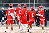 Baldwinsville Bees players Austin Bolton (15), Peter Fiorni III (13), Cole Peters (11) and Adam Davis (3) congratulate Brendan Wilcox (22) on his goal against the West Genesee Wildcats in Section III Boys Lacrosse action at Mike Messere Field in Camillus, New York on Tuesday, April 17, 2018.  Baldwinsville won 8-7.