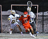Baldwinsville Bees Austin Bolton (15) is checked by West Genesee Wildcats Tom Baker (28) in Section III Boys Lacrosse action at Mike Messere Field in Camillus, New York on Tuesday, April 17, 2018.  Baldwinsville won 8-7.