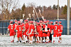 Baldwinsville Bees huddle up before playing the West Genesee Wildcats in a Section III Boys Lacrosse game at Mike Messere Field in Camillus, New York on Tuesday, April 17, 2018.