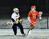 Baldwinsville Bees Austin Bolton (15) being defended by West Genesee Wildcats goalie Jack Corcoran (27) in Section III Boys Lacrosse action at Mike Messere Field in Camillus, New York on Tuesday, April 17, 2018.  Baldwinsville won 8-7.
