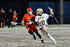 West Genesee Wildcats Brad James (20) with the ball against Baldwinsville Bees Brandon Mimas (21) in Section III Boys Lacrosse action at Mike Messere Field in Camillus, New York on Tuesday, April 17, 2018.  Baldwinsville won 8-7.