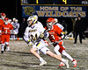 West Genesee Wildcats Ryan Smith (34) running with the ball past Baldwinsville Bees Adam Davis (3) in Section III Boys Lacrosse action at Mike Messere Field in Camillus, New York on Tuesday, April 17, 2018.  Baldwinsville won 8-7.