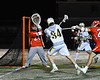 Baldwinsville Bees goalie J.J. Johnson (24) makes a save against West Genesee Wildcats Ryan Smith (34) in Section III Boys Lacrosse action at Mike Messere Field in Camillus, New York on Tuesday, April 17, 2018.  Baldwinsville won 8-7.
