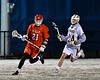 Baldwinsville Bees Brandon Mimas (21) running with the ball against West Genesee Wildcats Anthony Dattellas (24) in Section III Boys Lacrosse action at Mike Messere Field in Camillus, New York on Tuesday, April 17, 2018.  Baldwinsville won 8-7.