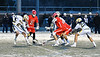 Baldwinsville Bees and West Genesee Wildcats players battle for a ground ball in Section III Boys Lacrosse action at Mike Messere Field in Camillus, New York on Tuesday, April 17, 2018.  Baldwinsville won 8-7.