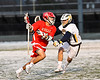 Baldwinsville Bees Cole Peters (11) being defended by West Genesee Wildcats Noah Sabatino (20) in Section III Boys Lacrosse action at Mike Messere Field in Camillus, New York on Tuesday, April 17, 2018.  Baldwinsville won 8-7.