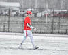Baldwinsville Bees Peter Fiorni III (13) walks out onto the snowy field at Michael Bragman Stadium in Cicero, New York on Thursday, April 19, 2018.