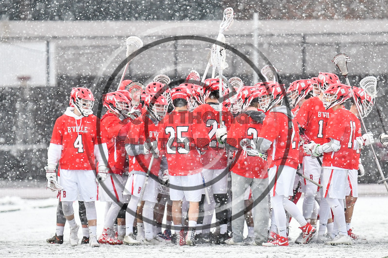 Baldwinsville Bees huddle up before playing the Cicero-North Syracuse Northstars in a Section III Boys Lacrosse game at Michael Bragman Stadium in Cicero, New York on Thursday, April 19, 2018.