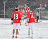 Baldwinsville Bees Brendan Wilcox (18) and Alexander Pompo (12) have a discussion whole playing the Cicero-North Syracuse Northstars in Section III Boys Lacrosse action at Michael Bragman Stadium in Cicero, New York on Thursday, April 19, 2018.  Baldwinsville won 9-6.