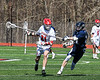 Baldwinsville Bees Brandon Mimas (21) cradling the ball against the Homer Trojans in Section III Boys Lacrosse action at the Pelcher-Arcaro Stadium in Baldwinsville, New York on Saturday, April 21, 2018.  Homer won 13-10.