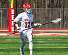 Baldwinsville Bees David Steria (12) with the ball against the Homer Trojans in Section III Boys Lacrosse action at the Pelcher-Arcaro Stadium in Baldwinsville, New York on Saturday, April 21, 2018.  Homer won 13-10.