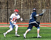 Baldwinsville Bees Braden Lynch (23) defending against Homer Trojans Tucker O'Donnell (2) in Section III Boys Lacrosse action at the Pelcher-Arcaro Stadium in Baldwinsville, New York on Saturday, April 21, 2018.  Homer won 13-10.