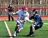 Baldwinsville Bees Cole Peters (11) driving against a  Homer Trojans defender in Section III Boys Lacrosse action at the Pelcher-Arcaro Stadium in Baldwinsville, New York on Saturday, April 21, 2018.  Homer won 13-10.
