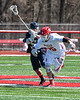 Baldwinsville Bees Cameron Slink (25) comes away with the ball after a face-off against the Homer Trojans in Section III Boys Lacrosse action at the Pelcher-Arcaro Stadium in Baldwinsville, New York on Saturday, April 21, 2018.  Homer won 13-10.