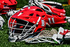Baldwinsville Bees helmets, sticks and gloves on the field before playing the Homer Trojans in a Section III Boys Lacrosse game at the Pelcher-Arcaro Stadium in Baldwinsville, New York on Saturday, April 21, 2018.