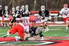 Baldwinsville Bees Michael Tangredi (26) facing off against Syracuse Cougars Ryan Eccles (37) in Section III Boys Lacrosse action at the Pelcher-Arcaro Stadium in Baldwinsville, New York on Tuesday, May 1, 2018.  Baldwinsville won 15-3.