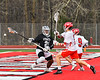 Baldwinsville Bees Tanner McCaffery (2) and Noah Ravas (9) defending against Syracuse Cougars Jerome Davis (21) in Section III Boys Lacrosse action at the Pelcher-Arcaro Stadium in Baldwinsville, New York on Tuesday, May 1, 2018.  Baldwinsville won 15-3.