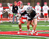 Syracuse Cougars Ryan Eccles (37) wins a face-off against Baldwinsville Bees Tanner McCaffery (2) in Section III Boys Lacrosse action at the Pelcher-Arcaro Stadium in Baldwinsville, New York on Tuesday, May 1, 2018.  Baldwinsville won 15-3.