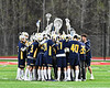 West Genesee Wildcats huddle up before playing the Baldwinsville Bees in a Section III Boys Lacrosse game at the Pelcher-Arcaro Stadium in Baldwinsville, New York on Thursday, May 3, 2018.