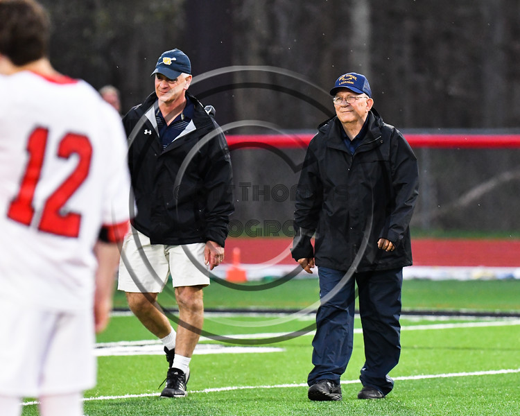 Baldwinsville Bees Seniors honored West Genesee  Wildcats Head Coach Mike  Messere before a Section III Boys Lacrosse game at the Pelcher-Arcaro Stadium in Baldwinsville, New York on Thursday, May 3, 2018.