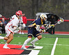 West Genesee Wildcats Patrick Stanistreet (25) wins a face-off against the Baldwinsville Bees Michael Tangredi (26) in Section III Boys Lacrosse action at the Pelcher-Arcaro Stadium in Baldwinsville, New York on Thursday, May 3, 2018.  West Genesee won 15-6.