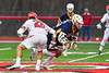 West Genesee Wildcats Patrick Stanistreet (25) wins one of many face-offs against the Baldwinsville Bees Michael Tangredi (26) in Section III Boys Lacrosse action at the Pelcher-Arcaro Stadium in Baldwinsville, New York on Thursday, May 3, 2018.  West Genesee won 15-6.