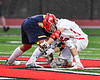 Baldwinsville Bees Cameron Slink (25) facing off against West Genesee Wildcats Patrick Stanistreet (25) in Section III Boys Lacrosse action at the Pelcher-Arcaro Stadium in Baldwinsville, New York on Thursday, May 3, 2018.  West Genesee won 15-6.