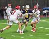 West Genesee Wildcats Tom Baker (28) gets sandwiched between Baldwinsville Bees defenders in Section III Boys Lacrosse action at the Pelcher-Arcaro Stadium in Baldwinsville, New York on Thursday, May 3, 2018.  West Genesee won 15-6.