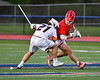 Baldwinsville Bees Tanner McCaffery (2) facing off against Liverpool Warriors Jake Piseno (21) in Section III Boys Lacrosse action at Liverpool High School Stadium in Liverpool, New York on Thursday, May 10, 2018.  Baldwinsville won 16-11.