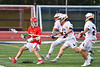 Baldwinsville Bees Tanner McCaffery (2) being defended by Liverpool Warriors players in Section III Boys Lacrosse action at Liverpool High School Stadium in Liverpool, New York on Thursday, May 10, 2018.  Baldwinsville won 16-11.