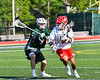 Baldwinsville Bees Cole Peters (11) with the ball against Fayetteville-Manlius Hornets Nicholas Papa (3) in Section III Class A Semi-Finals Boys Lacrosse action at Michael Bragman Stadium in Cicero, New York on Thursday, May 24, 2018.  Fayetteville-Manlius won 8-7.
