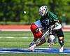 Fayetteville-Manlius Hornets Zachary VanValkenburgh (37) wins a face-off against Baldwinsville Bees Jake Walsh (4) in Section III Class A Semi-Finals Boys Lacrosse action at Michael Bragman Stadium in Cicero, New York on Thursday, May 24, 2018.  Fayetteville-Manlius won 8-7.