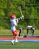 Baldwinsville Bees Cole Peters (11) celebrates his goal against the Fayetteville-Manlius Hornets in Section III Class A Semi-Finals Boys Lacrosse action at Michael Bragman Stadium in Cicero, New York on Thursday, May 24, 2018.  Fayetteville-Manlius won 8-7.